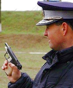 politist foc de arma