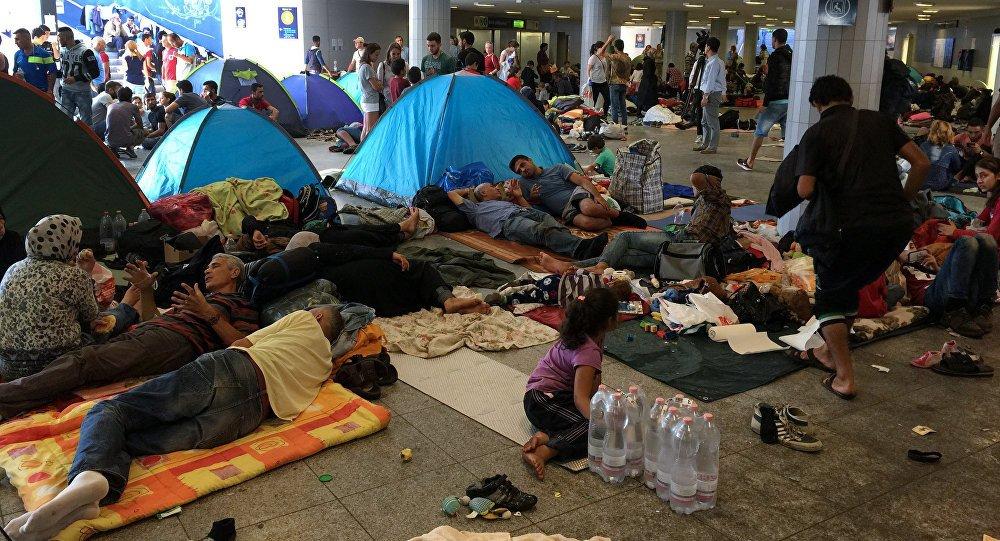 refugiati migranti